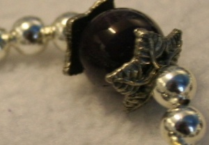 A close up of the bead caps surrounding the amethyst.